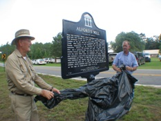 Bill Alford (left) unveils sign with Commissioner Kenneth Pridgen (right)