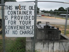 signage near used motor oil facility sayinig this waste oil container is provided for your convenience at no charge